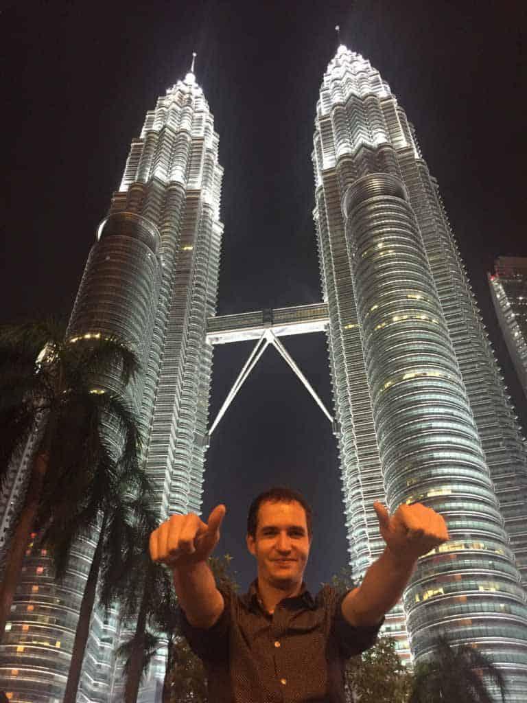 Petr, NEXT Academy's graduate in front of Petronas twin towers at Kuala Lumpur, Malaysia